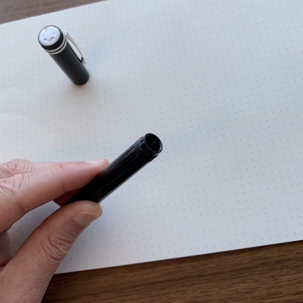 With the nib retracted.