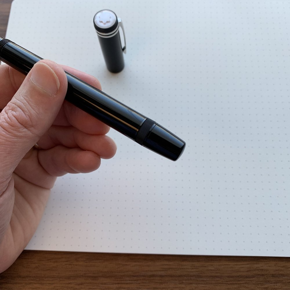In its standard position, the piston knob rotates to extend/retract the nib.