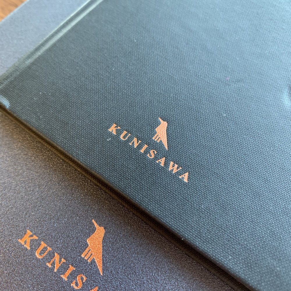 One thing Kunisawa nailed was the logo and the texture of the covers. The Smart Note (top) feels like an old-school pocket ledger, and the A5 Hard notebook features a sheeny vinyl that also feels nice in the hand.