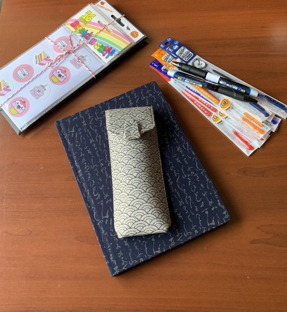 My Musubi journal and pen case, as well as my CW Pencils package (tastefully wrapped, as always), and some  Hi-Tec-C Coleto refills  and  .38mm Uniball Jetstreams  I picked up at Kinokuniya.