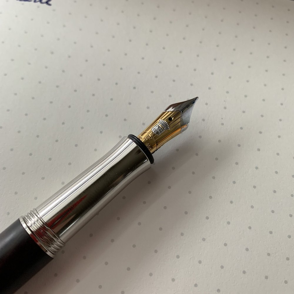 At first I wasn't sure how I felt about the two-toned gold nib, but ultimately I think it works paired with the dark brown wood.