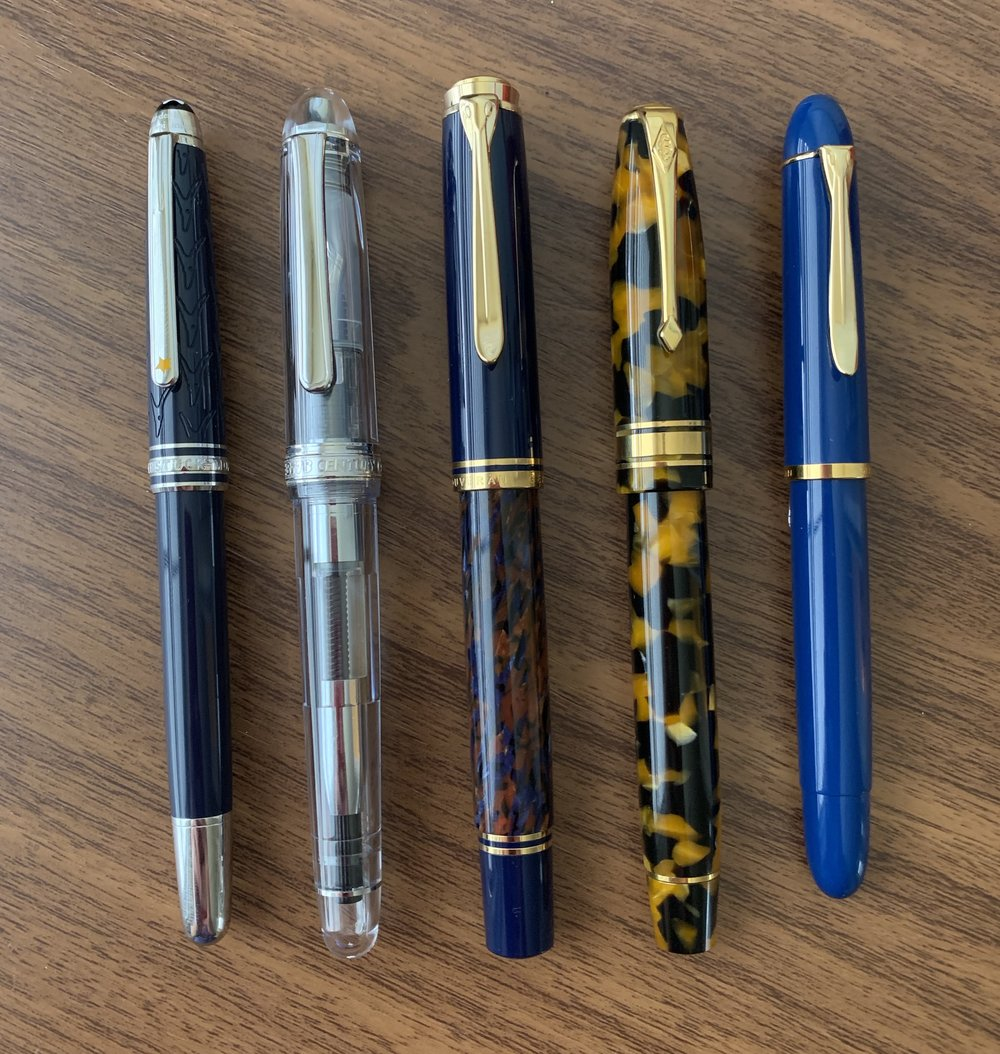 This year's favorite acquisitions, from left: Montblanc Le Petit Prince Classique Rollerball; Platinum 3776 Oshino Demonstrator; Pelikan M800 Stone Garden; Conway Stewart Model 100; Pelikan M120 Iconic Blue.