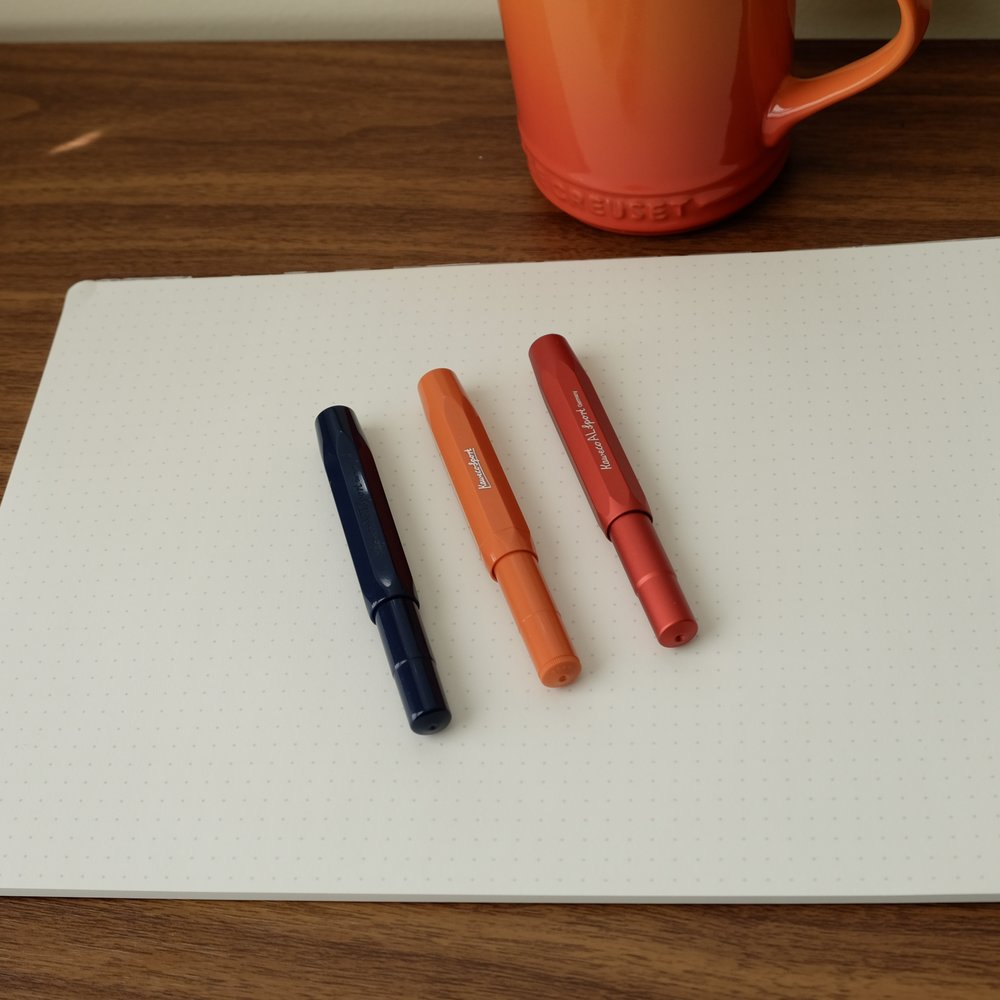 "From left, the Kaweco Art Sport in Dark Blue, the Kaweco Skyline Sport in ""Fox,"" and the Kaweco AL Sport in Red."