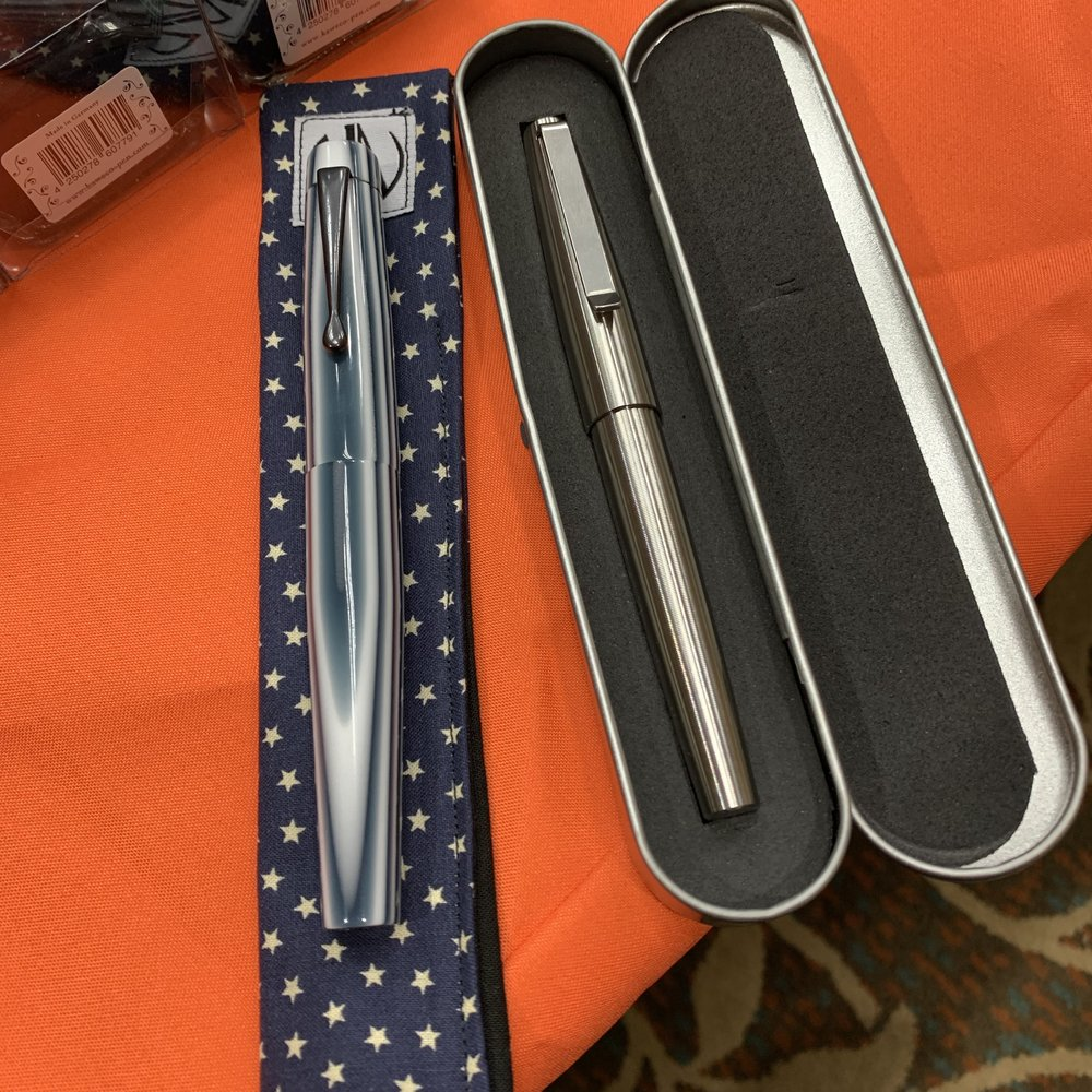 Two of the pens that I picked up at the Arkansas Pen Show: a Townsend in Pinstripe Acrylic by Shawn Newton, and a Tactile Turn Titanium Gist by Will Hodges. I brought home a couple other pens as well, but am saving those for a future announcement!