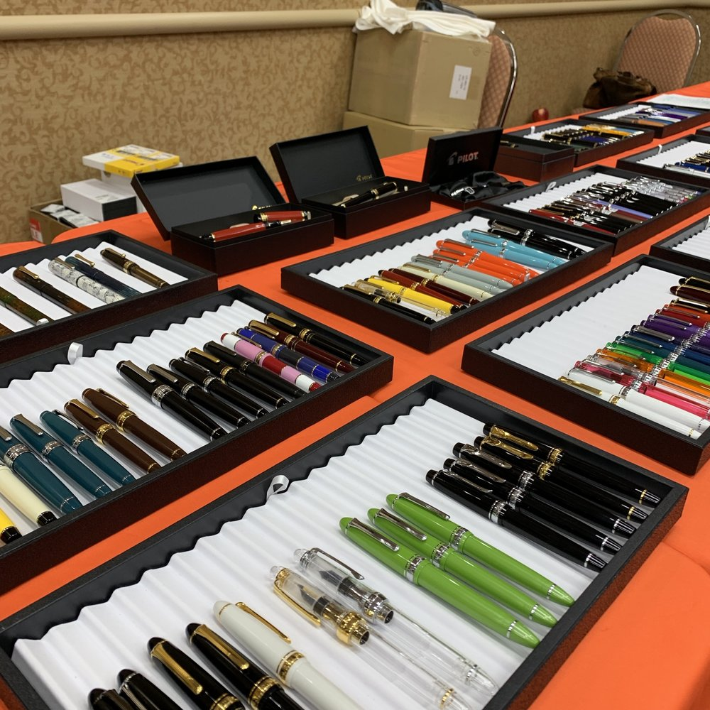 Dan Smith of The Nibsmith showed up with a massive selection of Sailors, Auroras, Pelikans, and more! I helped out behind his table on Saturday afternoon and Dan had steady traffic (in addition to grinding away)!