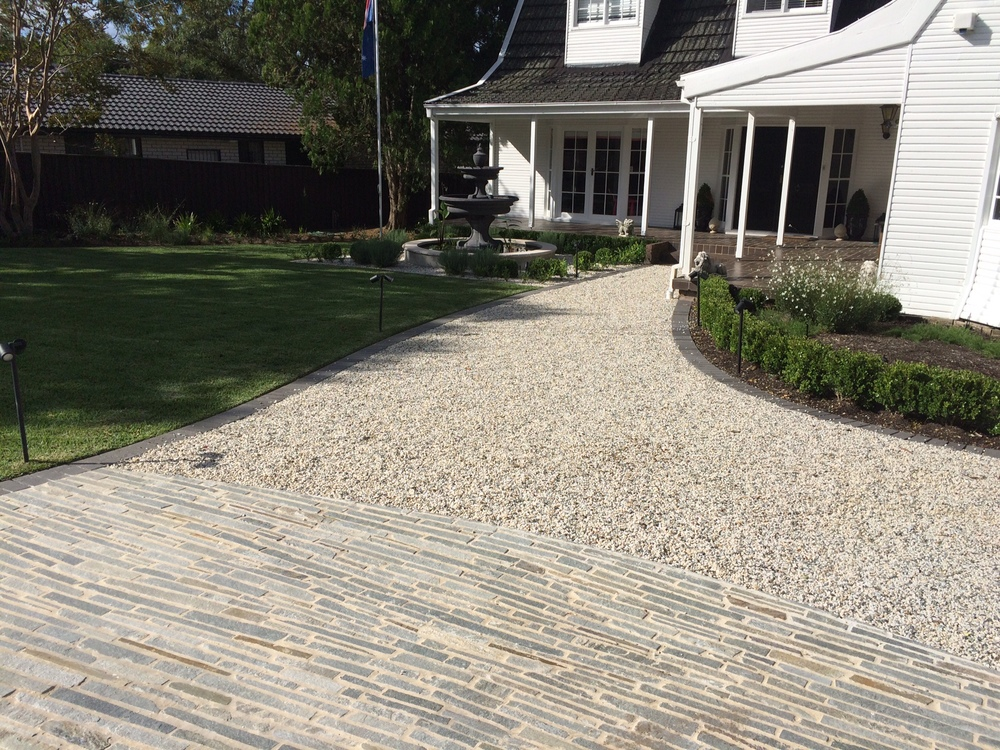 image from our St Ives project where the pebble pathway meets the driveway built from the Filetti range