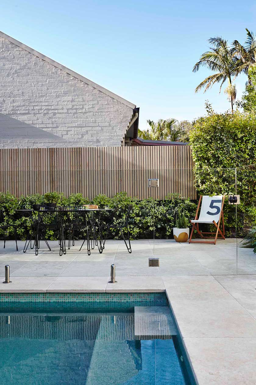 Lighter, large pavers open up this pool surround at our Balmain Garden project.  Image by Natalie Hunfalvay
