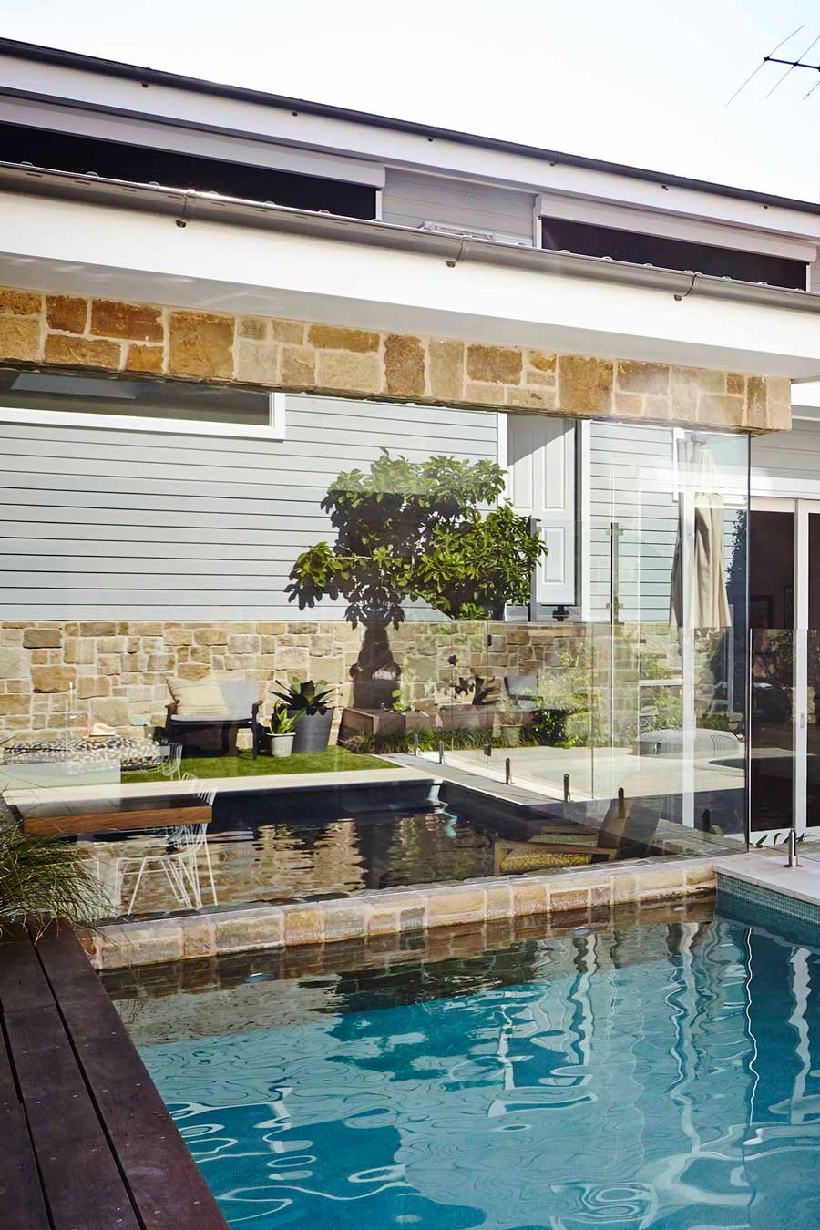 Compliment the home by making use of existing materials to extend out to your pool surround. Image by Natalie Hunfalvay