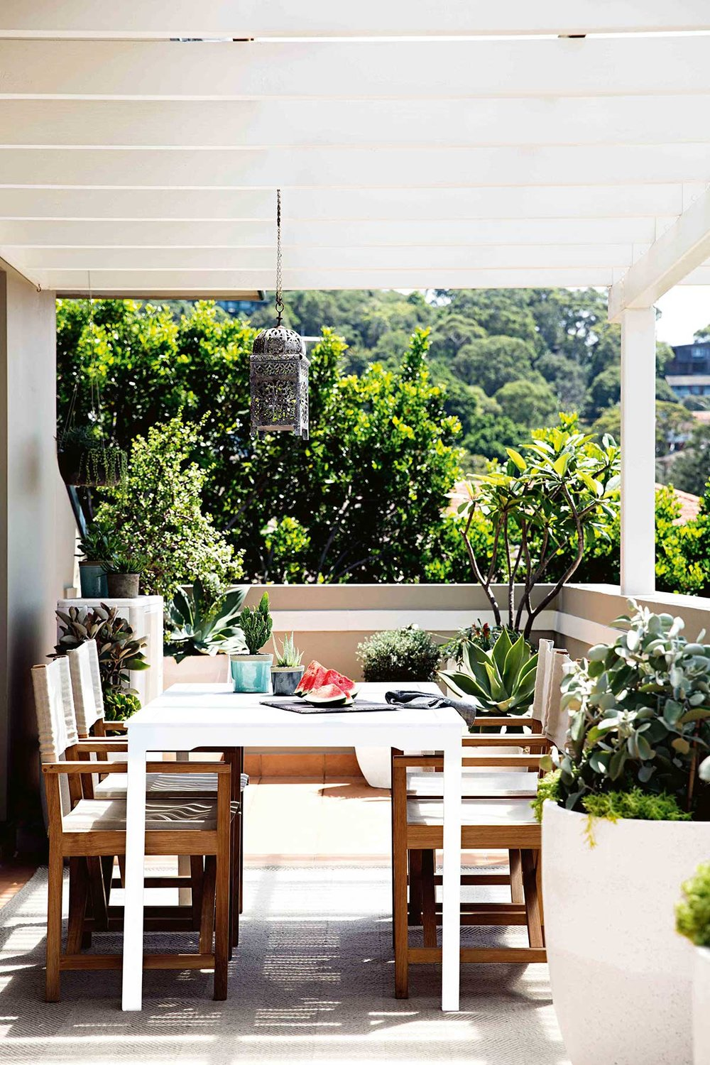 The balcony had ample space for formal outdoor dining and a variety of pot clusters and plant selection