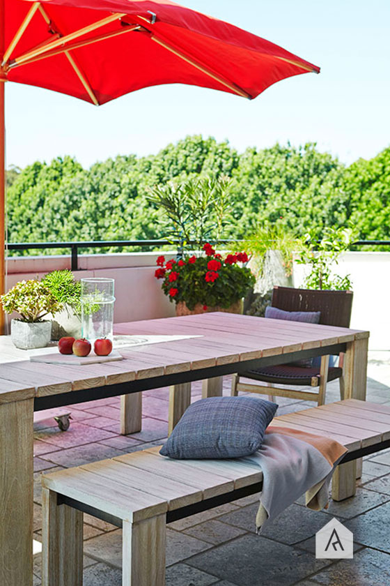 Glass to accessorise and a vibrant outdoor umbrella will breath new life in to your outdoor space