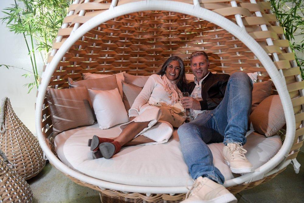 Nadine Bush and Jason Sullivan getting cosy inside Dedon's Nest Rest.