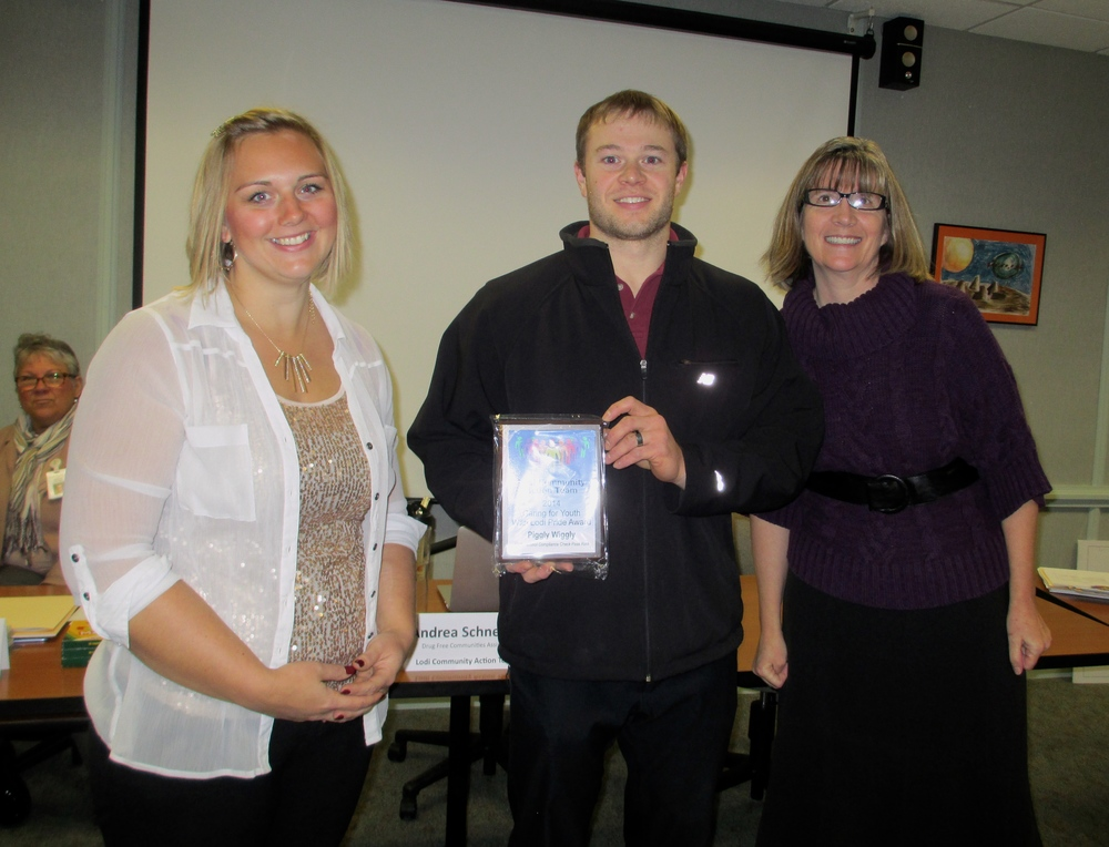 Piggly Wiggly team members receive their award! Pictured left-to-right: Tegan Krueger, Bryce Haessly & Paula Enger (LCAT Project Coordinator)
