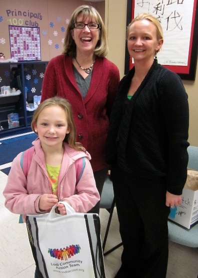 Pictured (left-to-right): Paula Enger (LCAT Project Coordinator), Nellie Starich & daughter