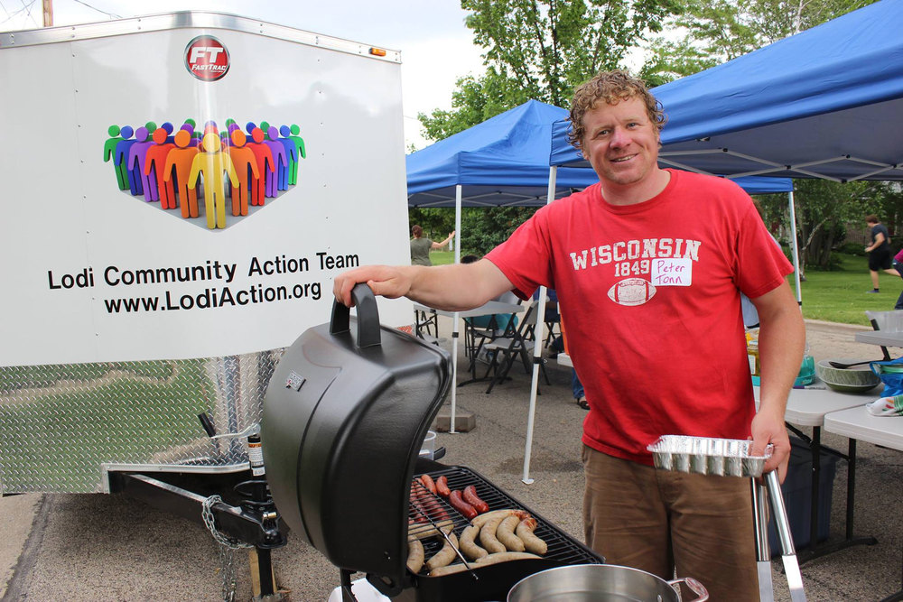 Pictured above is Peter Tonn, who is using the gas grill from the LCAT Block Party Wagon during the annual Elizabeth Street Block Party in June 2014.  Also pictured are the chairs, tables and blue tents from the wagon.  (Photo compliments of Paula Tonn)
