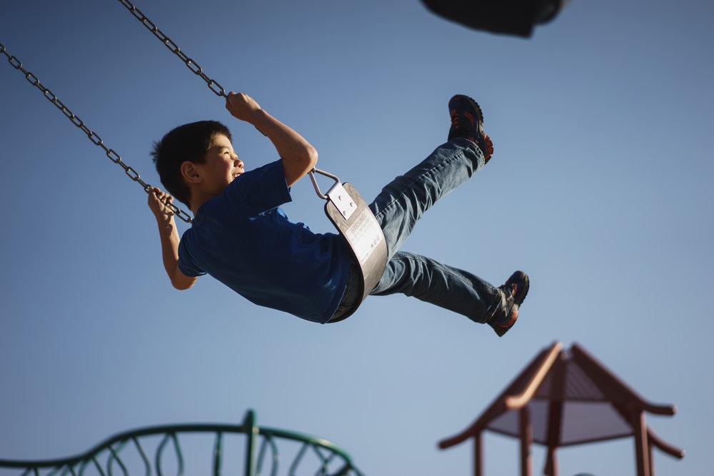 kid on swing.jpeg