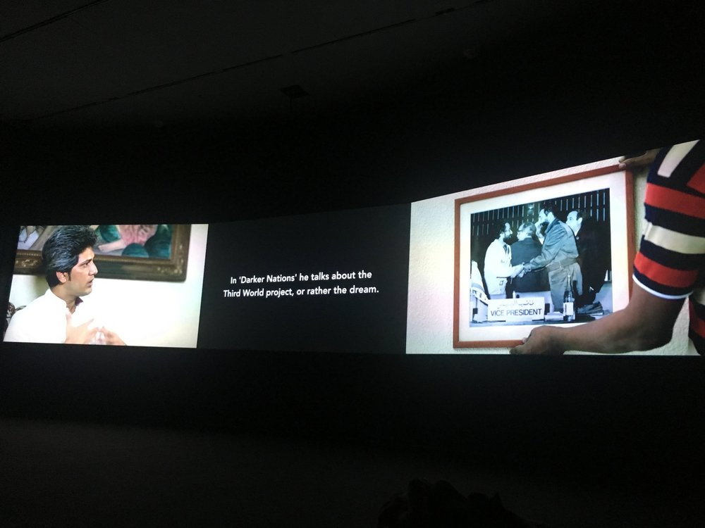 "Naeem Mohaeimen's ""Two Meetings and a Funeral,"" when the archive looks back at you. Three channel film Installation at the Art Institute of Chicago."