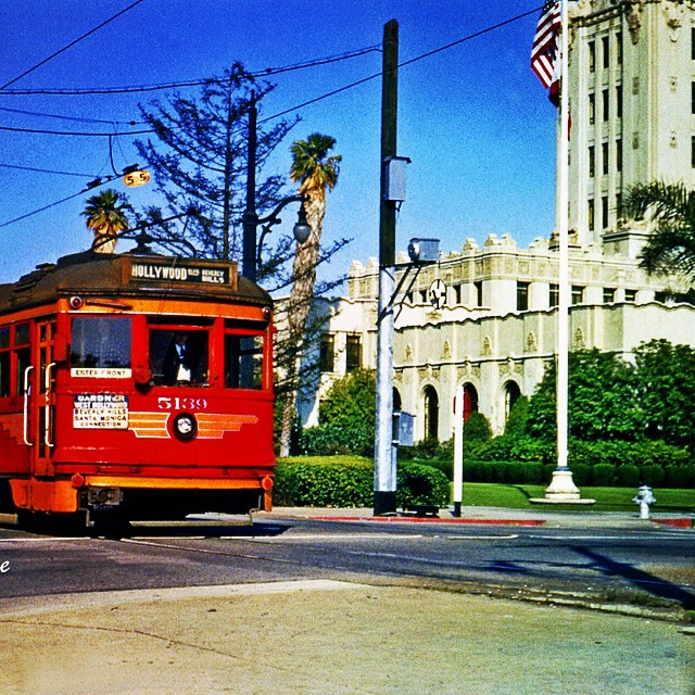The Pacific Electric Railway Venice Line #14 whizzes by Beverly Hills City Hall on Santa Monica Blvd. at Crescent Drive in 1950. Once upon a time Santa Monica Blvd. was known as Railway Avenue and carried the Balloon Route through downtown Los Angeles, all the way out to the oceans shore and back again.