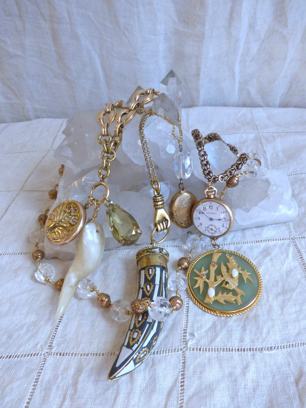 Vintage gold filled and brass charms, carved quartz skull beads, and antique gold filled chains.