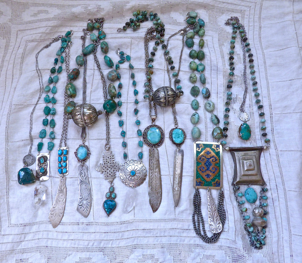 Necklaces of turquoise beads, hand set in wire, repurposed Navajo money clips and belt buckles, Edwardian engraved knives, Tuareg medallions, Bedouin and Yemenite beads, quartz and buffalo nickels.