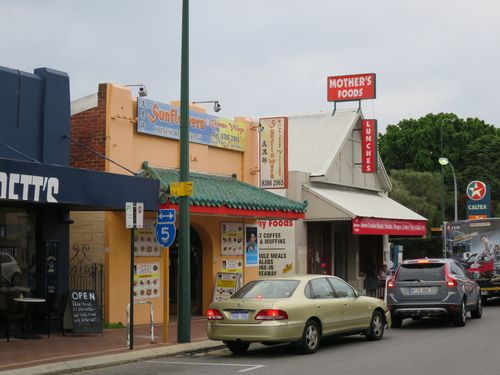 A beautiful trio of shopfronts in a Perth dusk. Broadway, Nedlands.