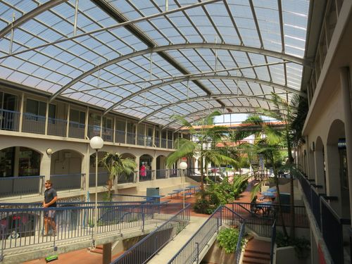 The incredible Broadway Fair Shopping Centre. A strata titled shopping centre (each little shop has a different landlord); it's this which has probably preserved it from redevelopment as it's unlikley all owners can syncopate to sell jointly to a developer.