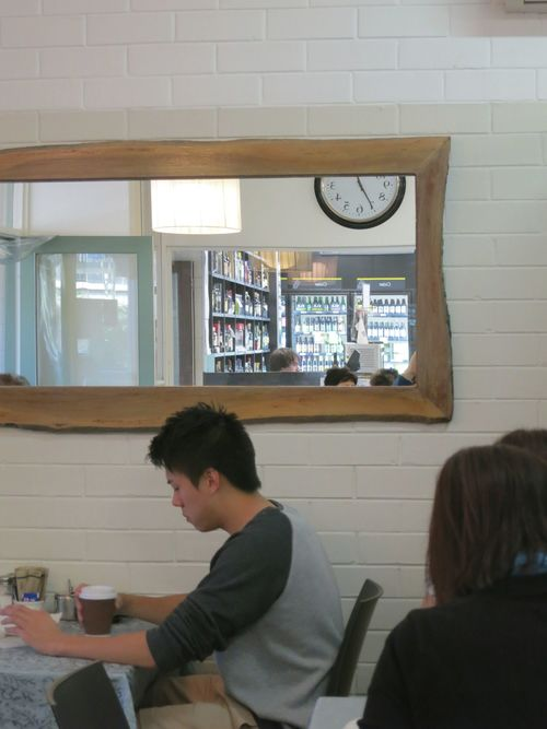 The shop next door adjoins this lunch bar with an opening in the wall and to the naked eye the mirror creates more space and activity in our dining room.