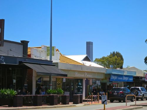 A typical Aussie mainstreet in the midday sun. Hampden Road, Nedlands, Australia.