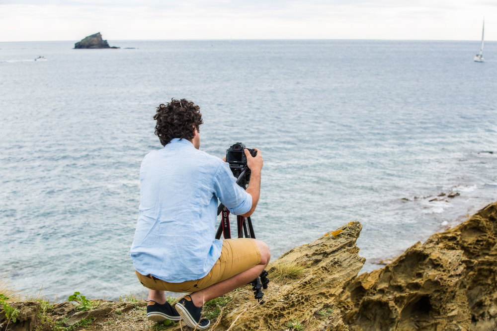 Arturo photographing the rock that Salvador Dalí would become obsessed with and include in many of his paintings.