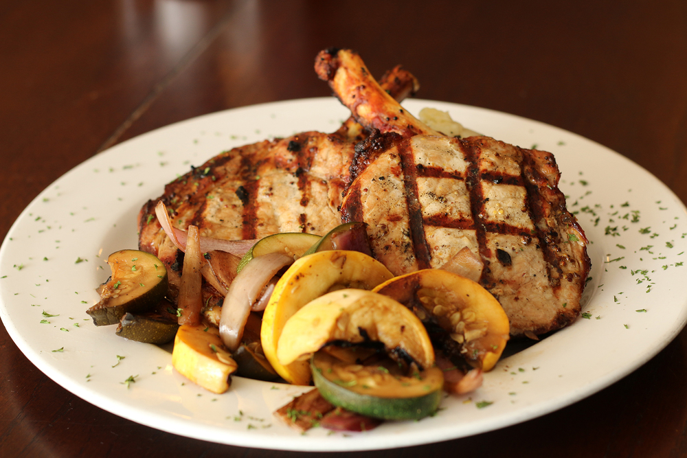 Enjoy our delicious Grilled Pork Chops with Basil Redskin Mashed Potatoes and Tuscan Vegetables.
