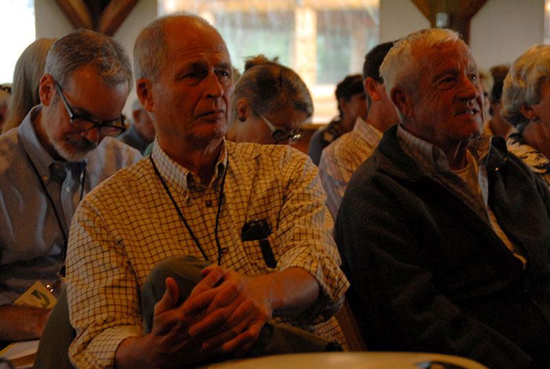 John Maclean listens with Alan Thomas behind him
