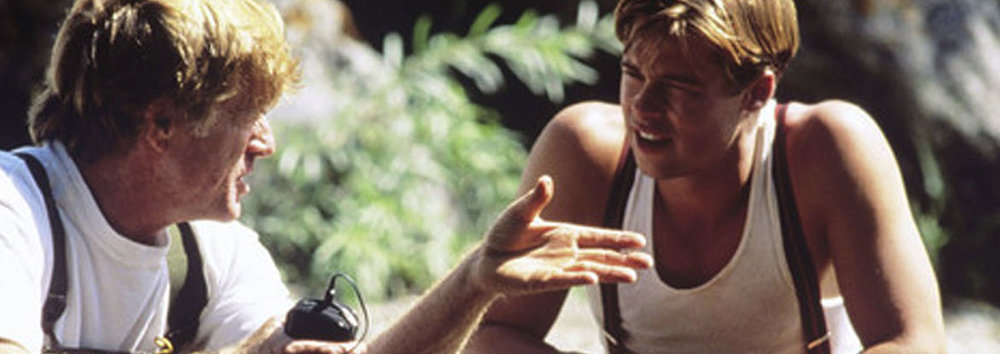 ROBERT REDFORD AND BRAD PITT DURING THE FILMING OF A RIVER RUNS THROUGH IT.