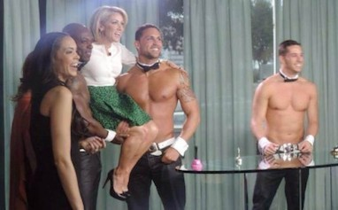Host Amy Kushnir was offended by a man-on-man kiss because children would see it, but she doesn't seem as bothered by half-naked men carrying her out on stage.