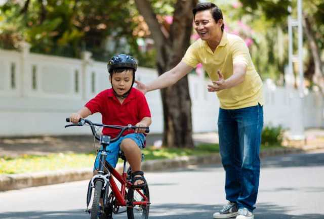 father-teaches-son-bike.jpg