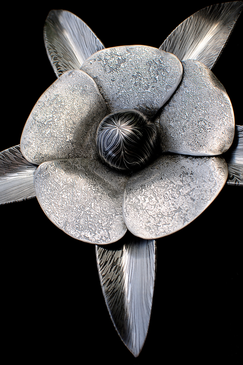 Pattern-welded Flower by Mick Maxen - AVAILABLE (set on driftwood with smaller flowers) - £2400. (This piece won the Reserve Show Champion at the Dorset Show).