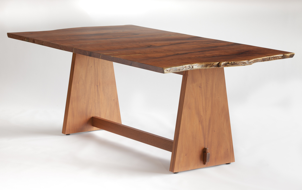 "This ""live-edge"" table features slabs hewn from south Texas mesquite. It displays a tabletop dimension of 79"" x 42"" and stands 29"" high. The african mahogany base follows a more contemporary ""trestle"" design.  Design by Reznikoff Custom Furniture"