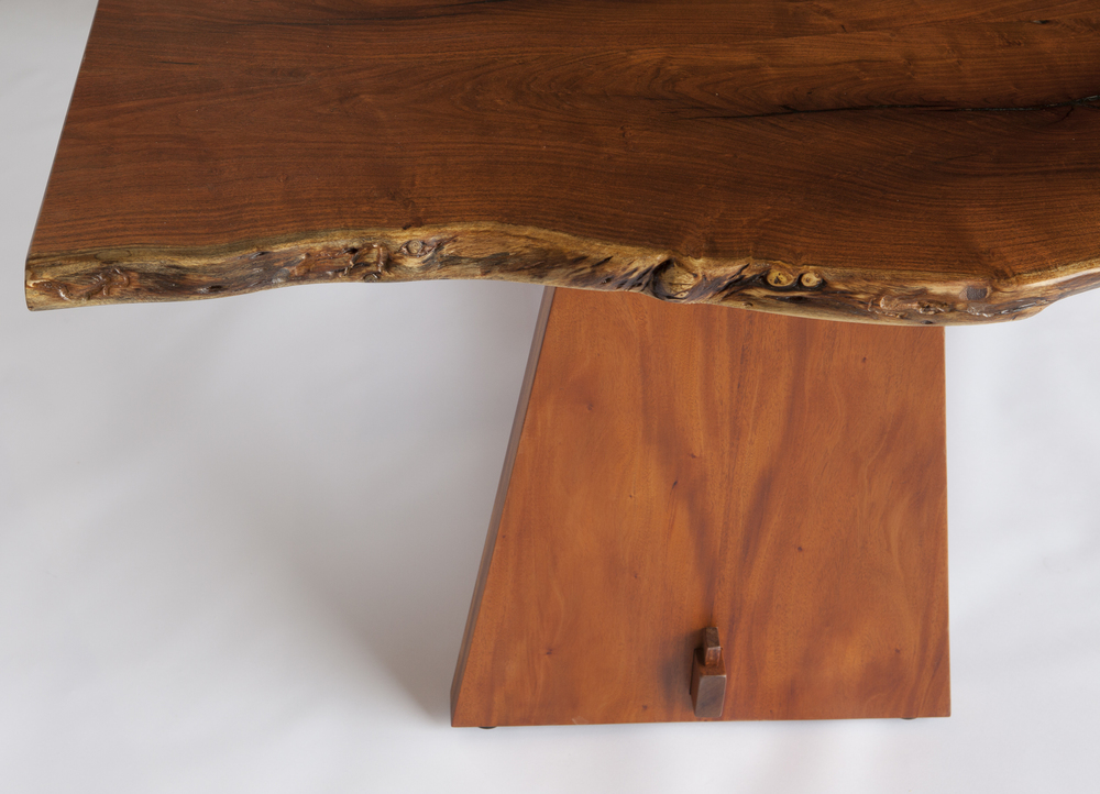 """This """"live-edge"""" table features slabs hewn from south Texas mesquite. It displays a tabletop dimension of 79"""" x 42"""" and stands 29"""" high. The african mahogany base follows a more contemporary """"trestle"""" design.  Design by Reznikoff Custom Furniture"""