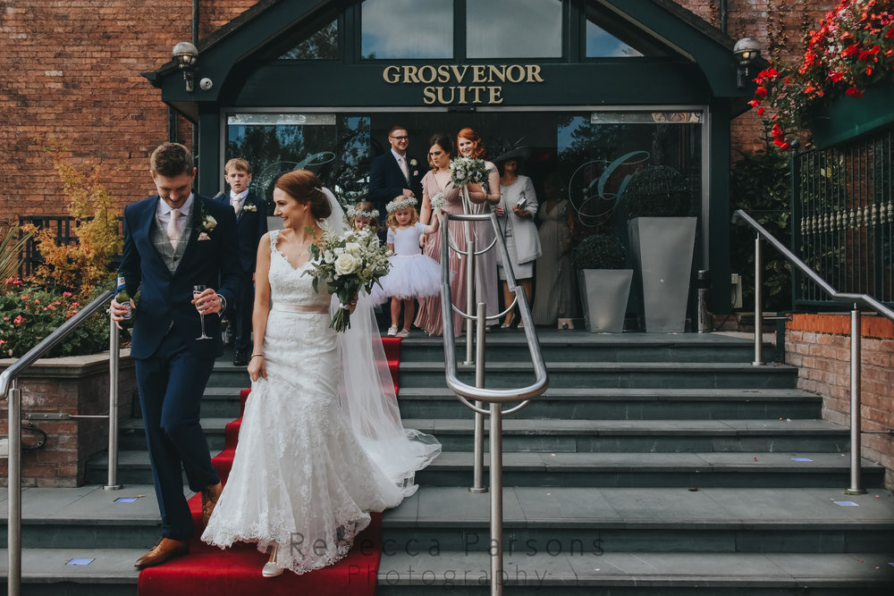 Newlyweds leaving the Grosvenor Pulford Hotel and Spa with guests