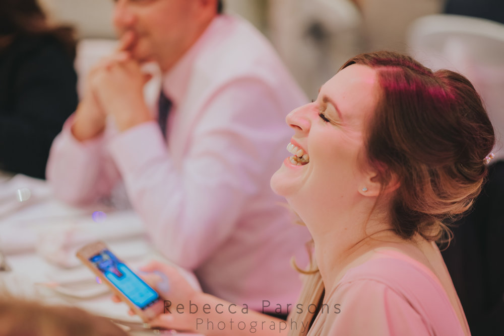 Bridesmaid laughing in speeches