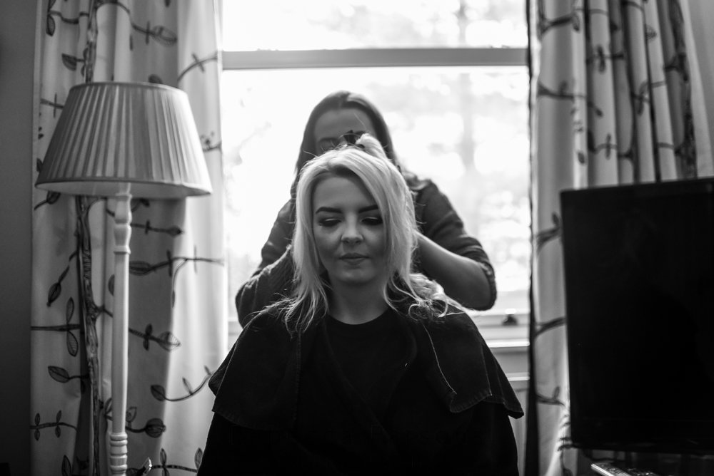 Bride having hair styled black and white