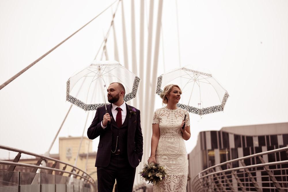 Bride and groom on bridge at Media City in Salford