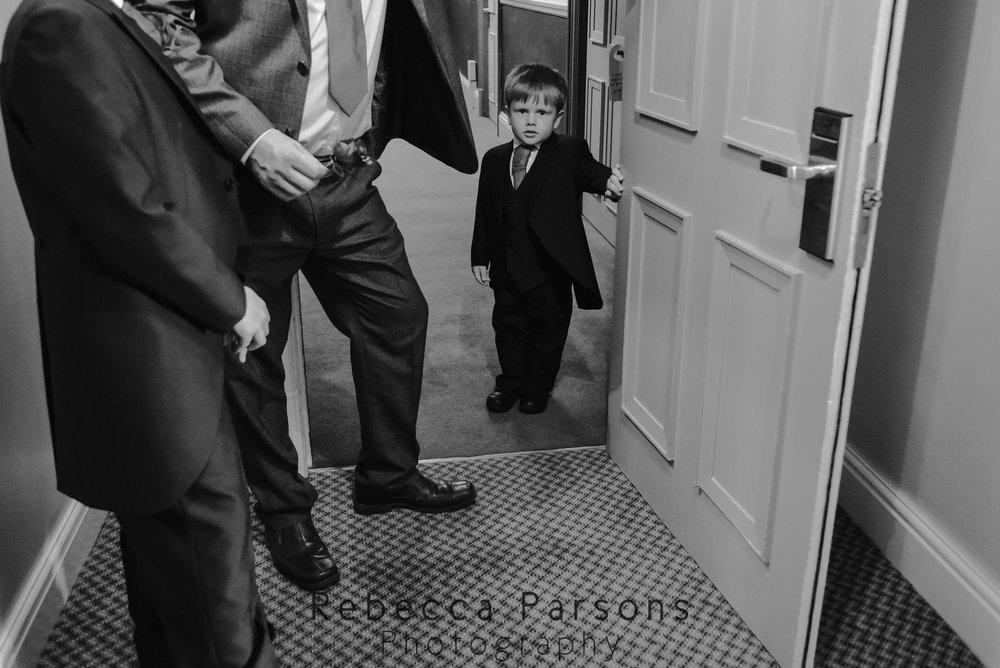 young-usher-standing-by-door