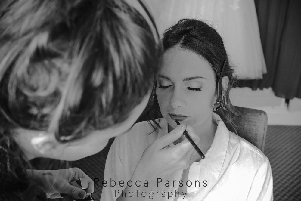 bridal make up being applied black and white
