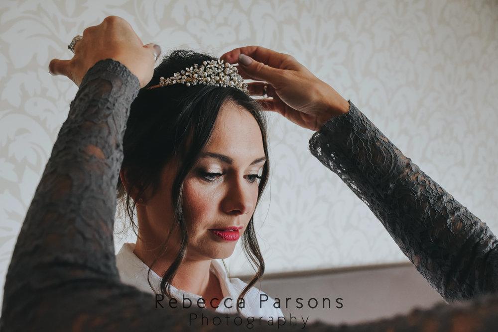 bride tiara being put in place