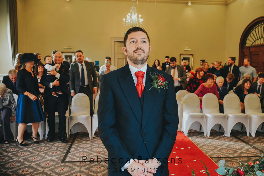 groom waiting for bride to walk down aisle