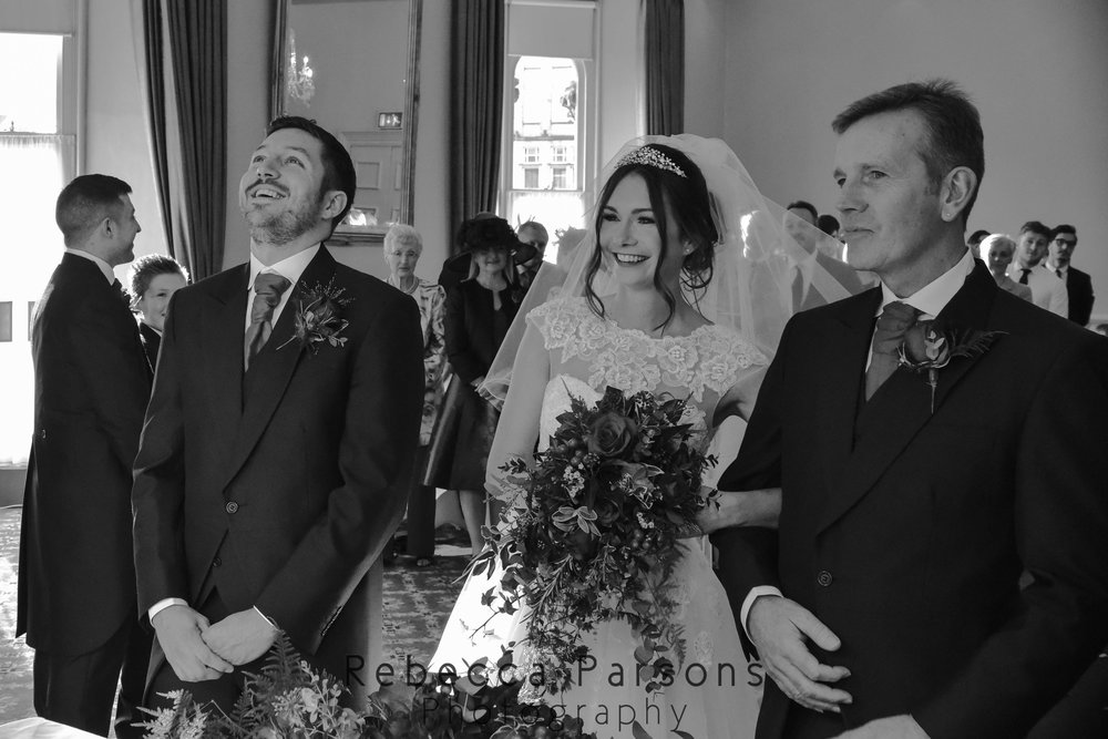 bride and groom see each other for first time black and white