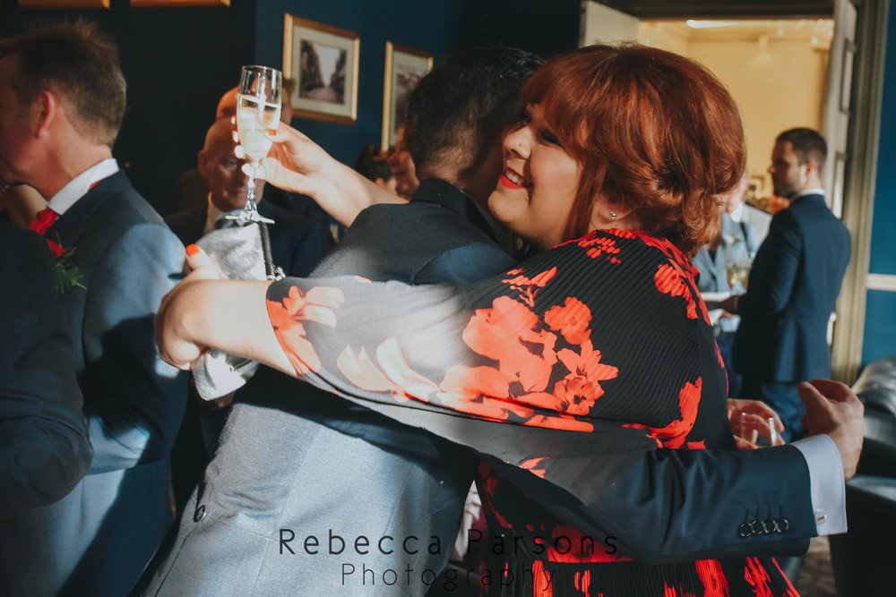 guest hugging groom