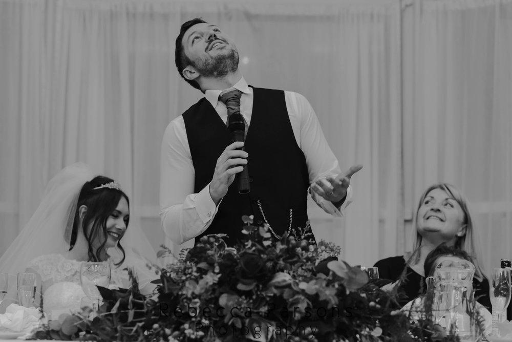groom giving speech black and white
