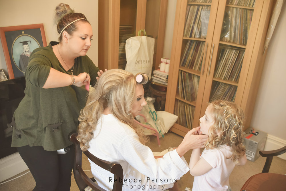 bride having hair styled while talking to niece