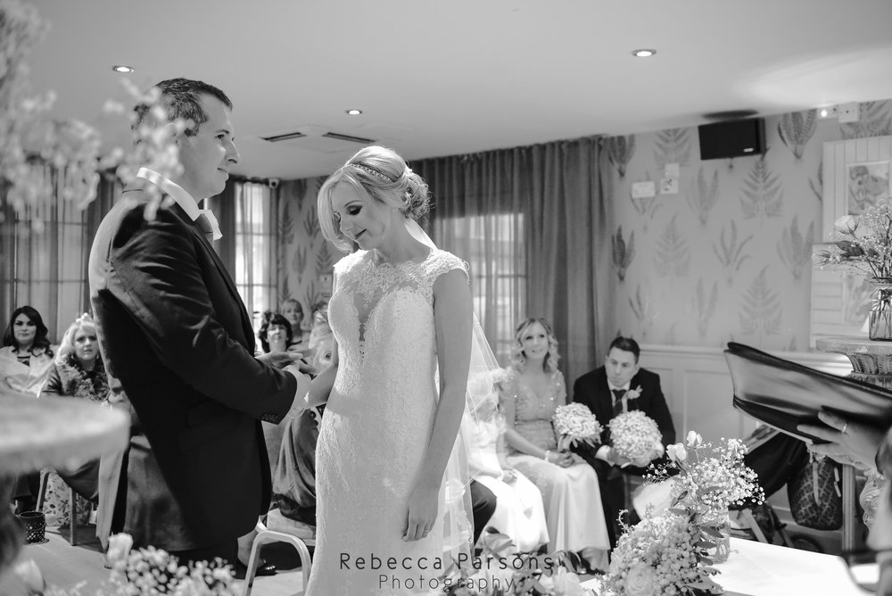 black and white bride and groom saying vows