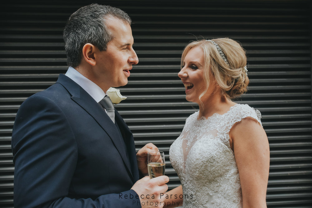 bride and groom talking on street close up